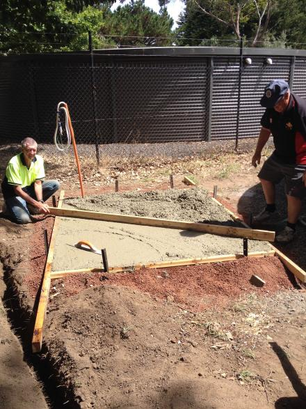 Twig & Ron screed the slab