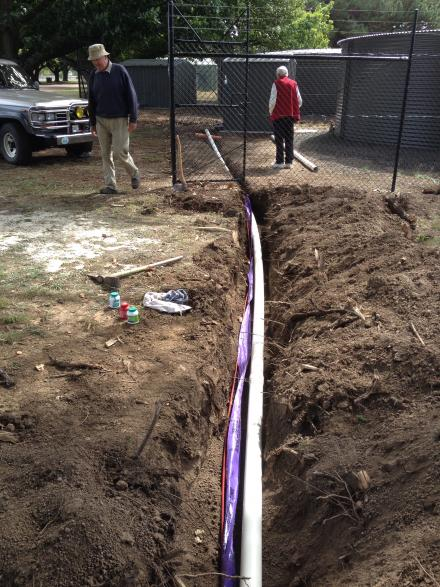 John L & Bruce make sure the final length of pipe is well glued and in the right place